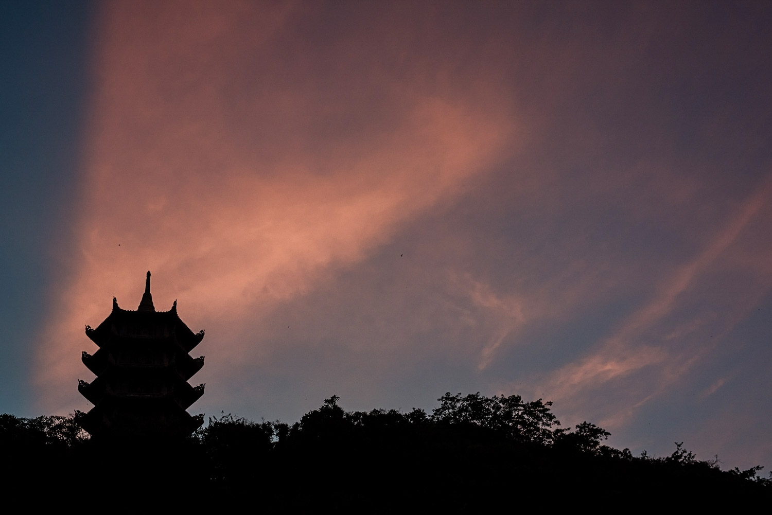 Silhouette of a pagoda on the marble mountains