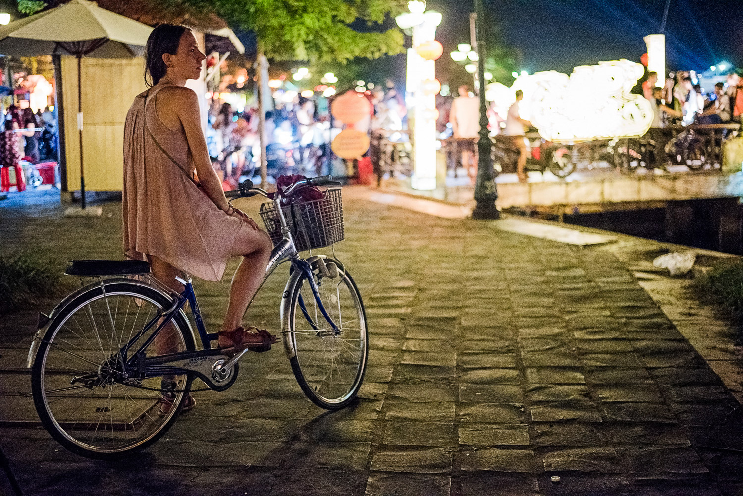 Tourist girl on a bicycle