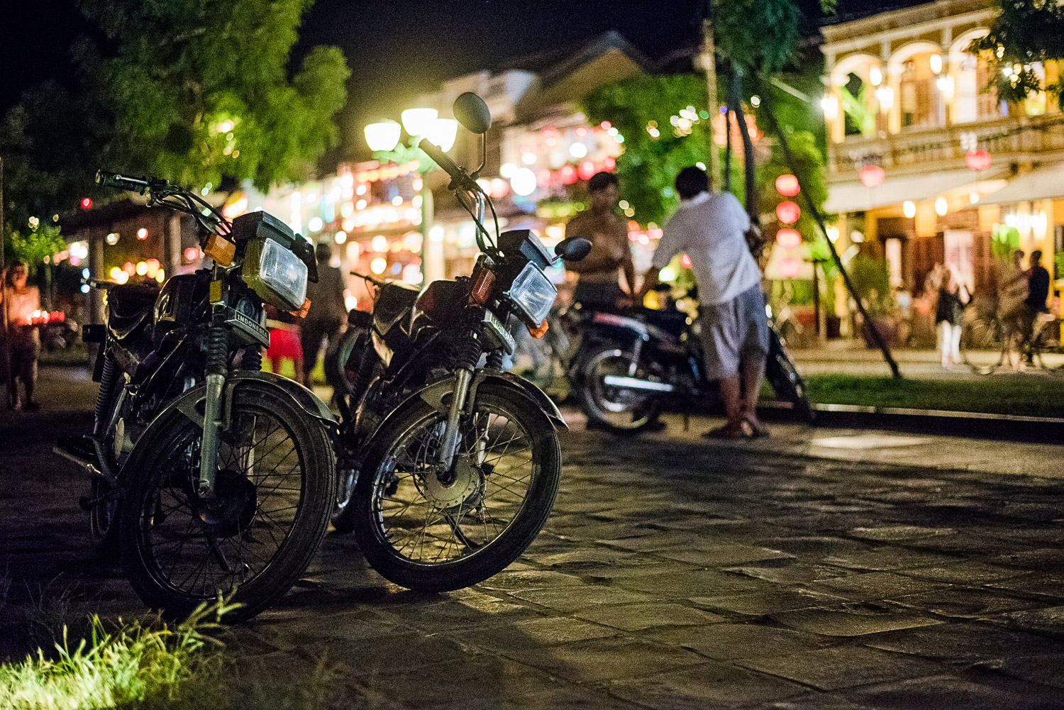 Our motorcycles and Hoi An by night