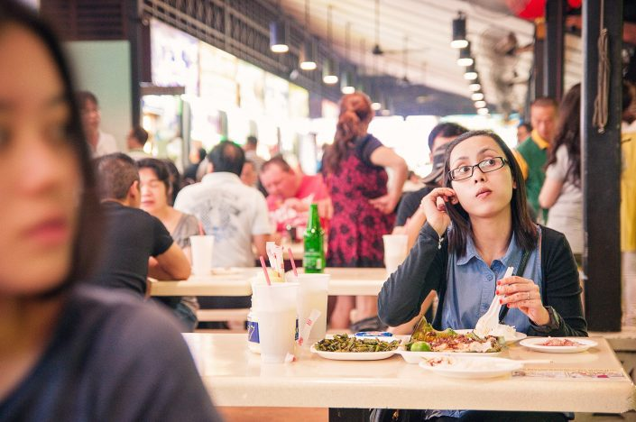 woman eating in netwon food centre singapore
