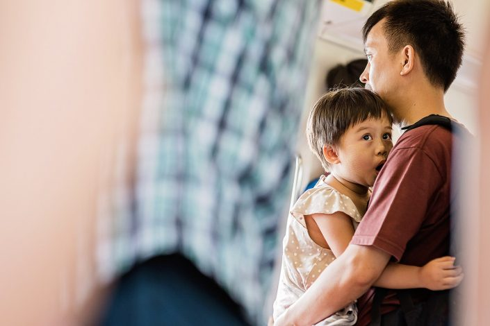 father and daughter on the mrt singapore