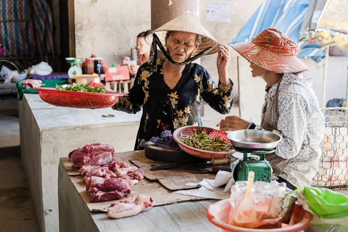 old woman negotiating at the market in thanh toan vietnam