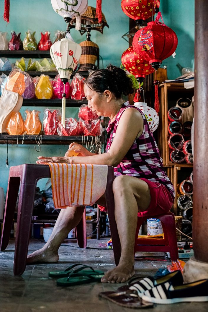 woman making traditional lanterns in hoi an