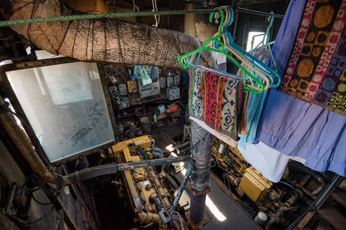 engine room used as laundry room on a ferry in vietnam