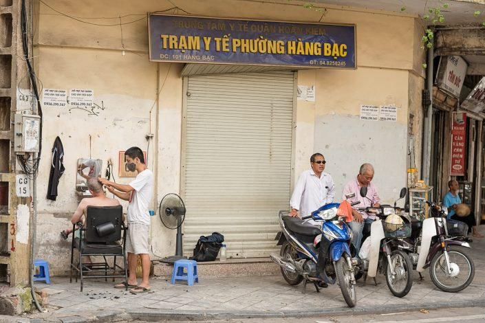 barber working on the streets of hanoi