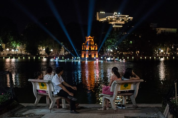 people in hanoi sitting in front of ngoc son temple